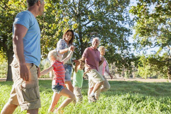 Family Enjoying Walk In Beautiful Countryside